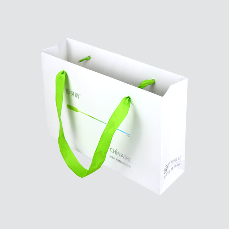 Shopping paper bag with handle