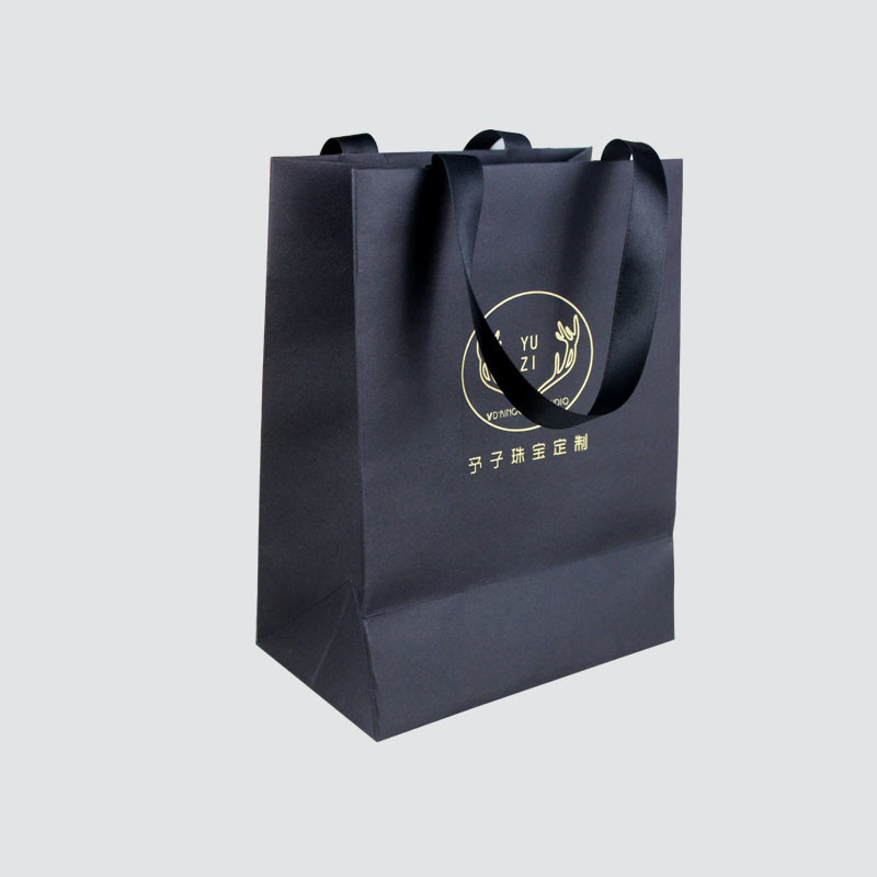 Shopping gift paper bag with ribbon